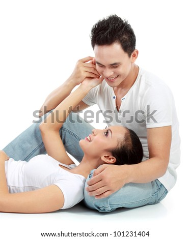portrait of asian happy couple relaxing isolated over white background - stock photo