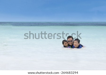 Portrait of asian man enjoy holiday with his children and swimming together - stock photo