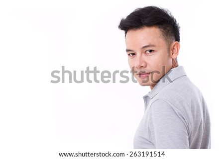 portrait of asian man looking over his shoulder - stock photo