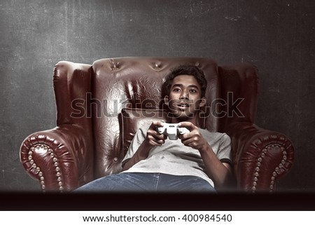 Portrait of asian man playing video games in his living room