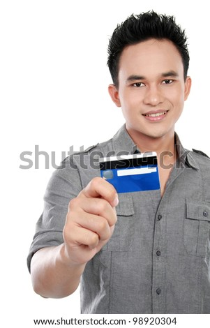 portrait of asian man showing credit card isolated on white background
