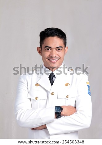 portrait of Asian man with government uniform smiling - stock photo