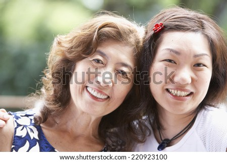 Portrait of Asian mother and adult daughter - stock photo