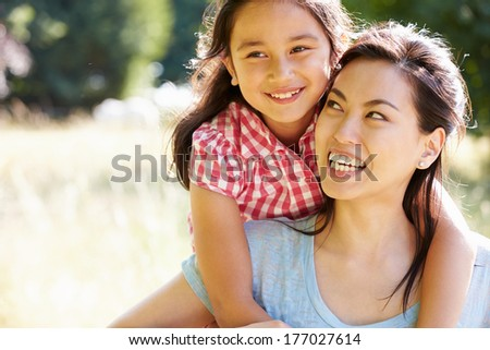Portrait Of Asian Mother And Daughter In Countryside - stock photo