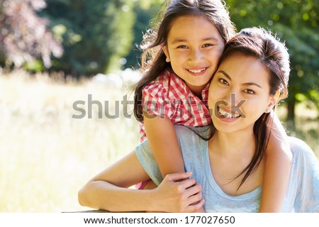 Portrait Of Asian Mother And Daughter In Countryside
