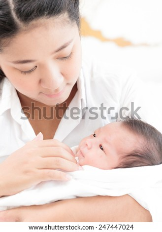 Portrait of asian mother and infant - stock photo