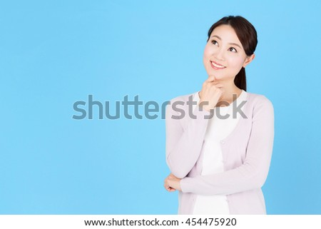 portrait of asian nurse isolated on blue background