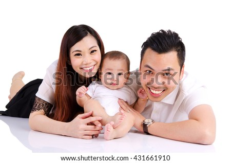 Portrait of asian parent and their six months old baby boy - stock photo