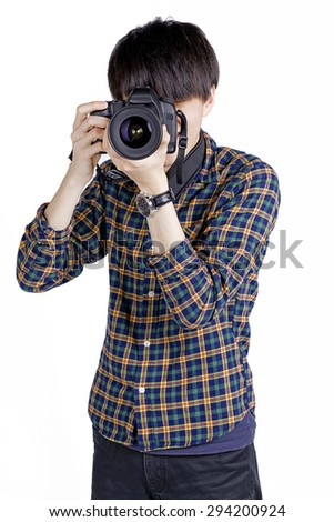 Portrait of asian photographer holding a digital camera on white background - stock photo