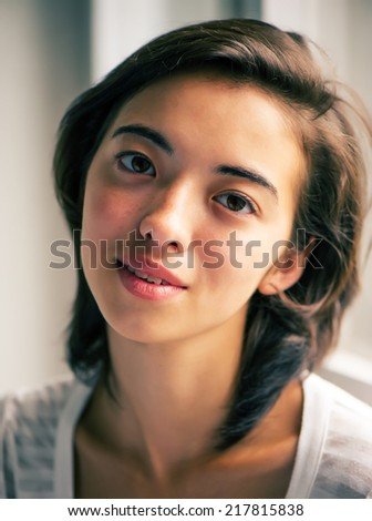portrait of Asian pretty girl who is looking at the camera