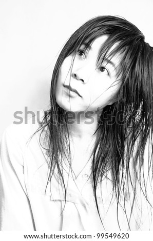 Portrait of asian pretty woman with wet hair,black and white - stock photo