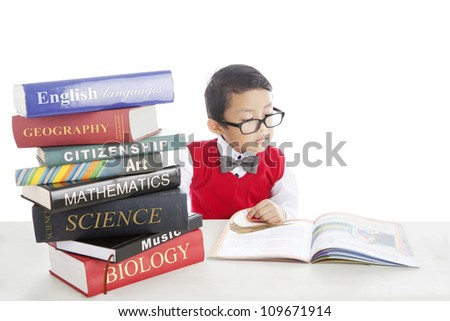 Portrait of asian pupil studying by reading books of lessons. shot in studio - stock photo
