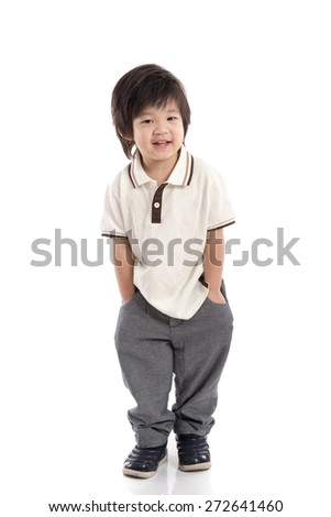 Portrait of Asian schoolboy with backpack standing isolated on white - stock photo