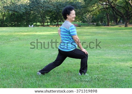 Portrait of Asian Senior Stretching in the park