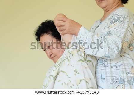 Portrait of Asian senior woman having a massage on bed,relaxing