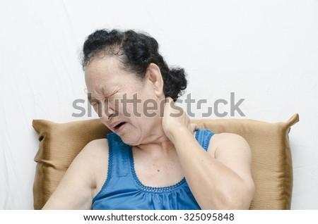 Portrait of asian senior woman neck pain expression - stock photo