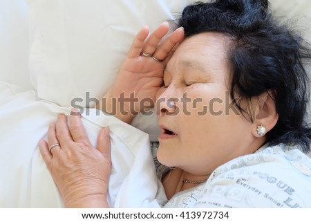 Portrait of Asian senior woman sleeping on bed