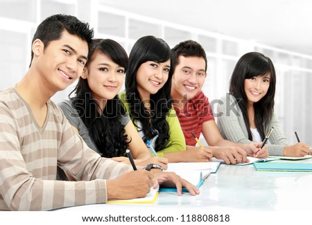 Portrait of asian students studying in the classroom - stock photo