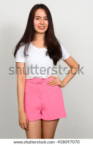 Portrait of Asian teenager girl smiling - stock photo