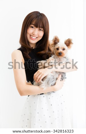 portrait of asian woman and dog in the room