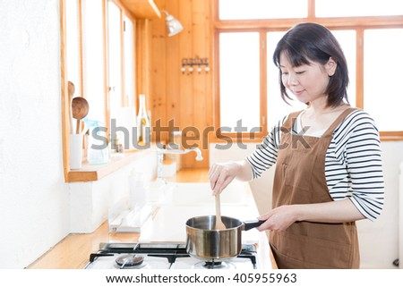 portrait of asian woman cooking in the kitchen