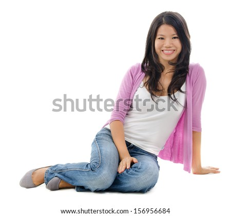 Portrait of Asian woman smiling and sitting isolated over white background. - stock photo