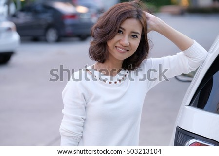 Portrait of asian woman smiling with car