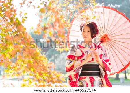 portrait of asian woman wearing japanese traditional kimono in autumn - stock photo