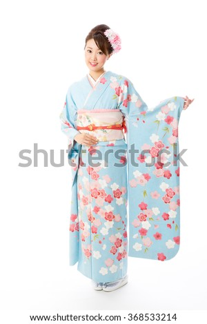 portrait of asian woman wearing kimono isolated on white background