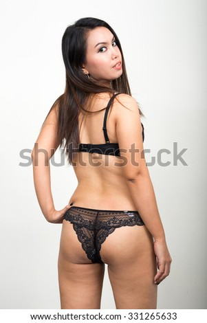 Portrait of Asian woman wearing underwear