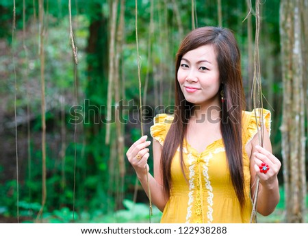 Portrait of Asian women standing in front of scenic jungle in Thailand forest