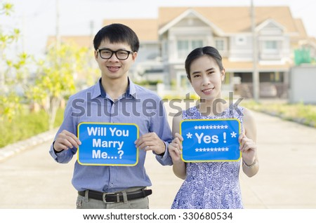 Portrait of Asian young couple in outdoor