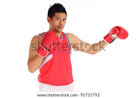 Portrait of asian young man with boxing gloves over white background - stock photo