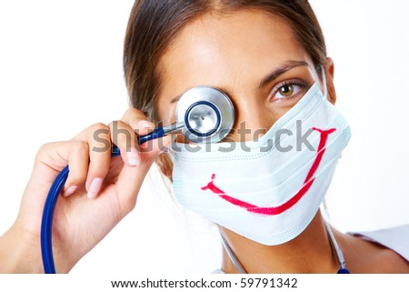 Portrait of assistant in mask with big smile on it looking at camera - stock photo