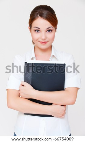portrait of assured businesswoman with black folder over grey background - stock photo