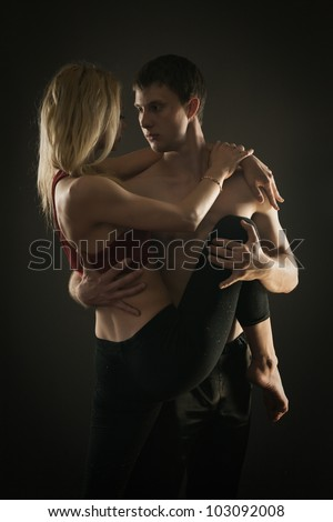 Portrait of athletic couple in sportswear over gray background - stock photo