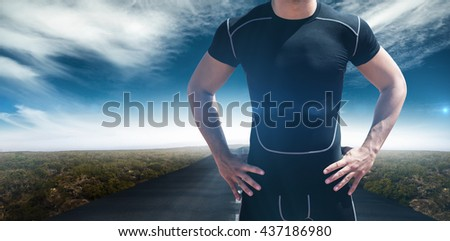 Portrait of athletic man chest against view of an empty street