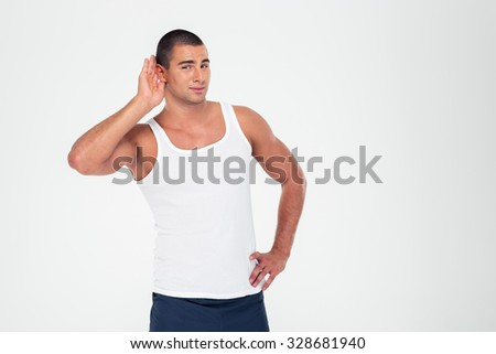 Portrait of athletic man holding his hand near his ear to listening something isolated on a white background - stock photo