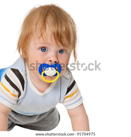 Portrait of attentive baby with a pacifier in his mouth