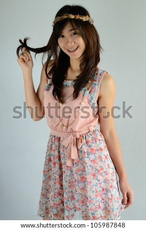 Portrait of attractive Asian girl posing - stock photo