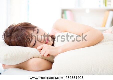 Portrait of attractive Asian girl sleeping on bed. Young woman indoors living lifestyle at home.