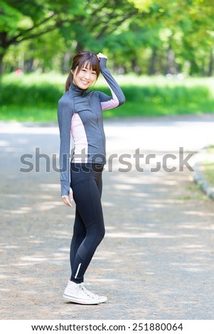 portrait of attractive asian woman in the park - stock photo
