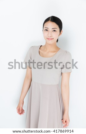 portrait of attractive asian woman wearing one piece dress isolated on white background - stock photo