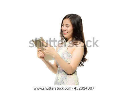 Portrait of attractive Beautiful Young Asian women using a tablet with happiness and concentrate. Female model isolated on white background.