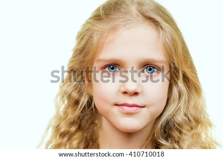 Portrait of attractive beautiful young blonde girl with blue eyes - stock photo