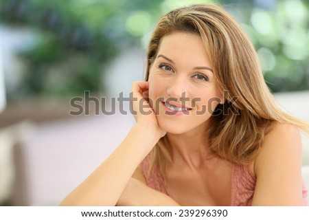 Portrait of attractive blond woman at home - stock photo
