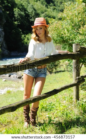 Portrait of attractive blonde on the ranch