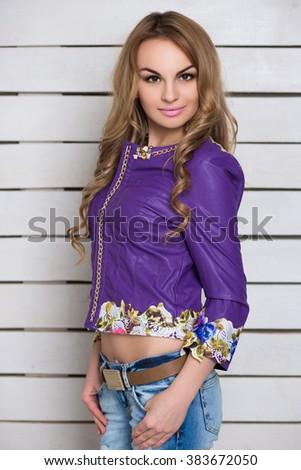 Portrait of attractive blonde wearing purple jacket - stock photo