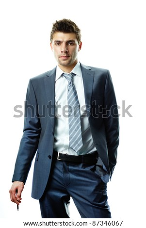 Portrait of attractive businessman in suit looking at camera