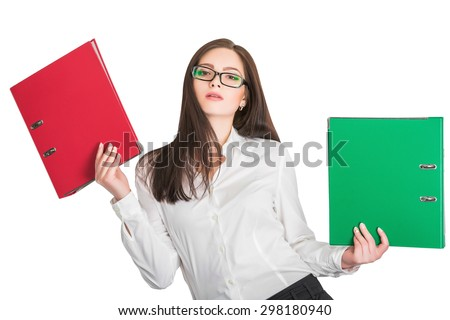 Portrait of attractive businesswoman in glasses holding red and green folders isolated on white background